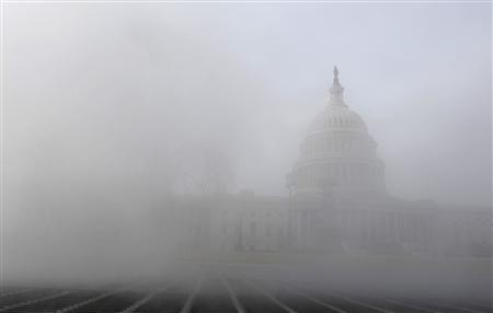 The U.S. Capitol, where President Obama will make his State of the Union address, is visible through steam rising from a grate in the frigid air in Washington, January 24, 2011. REUTERS/Jonathan Ernst