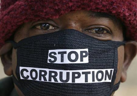 Sajja Murli Chaudhary, 45, an employee of telecom operator systems takes part in a silent protest against the telecom corruption scandal in New Delhi December 9, 2010. REUTERS/Parivartan Sharma/Files