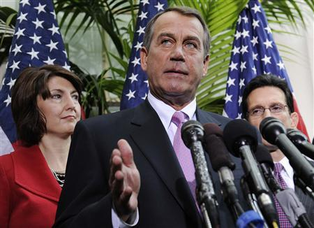 House Speaker John Boehner (R-OH) (C) stands with Representative Cathy McMorris Rodgers (R-WA) (L) and Majority Leader Eric Cantor (R-VA) (R) as he addresses reporters at the U.S. Capitol in Washington, January 25, 2011. REUTERS/Jonathan Ernst