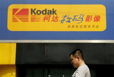 A Chinese man walks past a Kodak digital express shop in Beijing September 9, 2005. REUTERS/Jason Lee  LEE/TC/Files