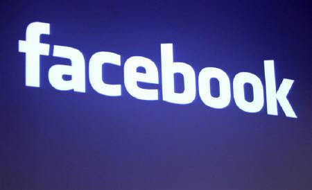 The Facebook logo is shown at Facebook headquarters in Palo Alto, California May 26, 2010. REUTERS/Robert Galbraith/Files
