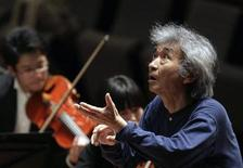<p>Maestro Seiji Ozawa conducts the Seiji Ozawa Ongaku-juku orchestra during a rehearsal at the National Theatre in Beijing April 15, 2009. REUTERS/Grace Liang</p>
