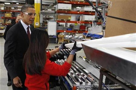 U.S. President Barack Obama tours Orion Energy Systems, a power technology company, as part of his Administration's White House to Main Street Tour, in Manitowoc, Wisconsin, January 26, 2011. REUTERS/Larry Downing