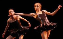 "<p>Maria Kochetkova (L) and Yekaterina Shipulina perform during a rehearsal for ""Reflections"" at the Bolshoi Theatre in Moscow January 26, 2011. REUTERS/Denis Sinyakov</p>"