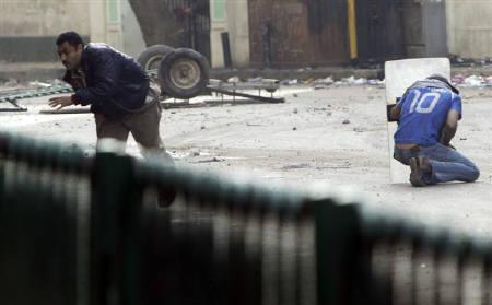 An Egyptian anti-government protester shields himself during clashes with riot police at Tahrir Square in downtown Cairo after wide-spread protests early January 29, 2011. REUTERS/Amr Abdallah Dalsh