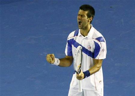 Novak Djokovic of Serbia reacts during his men's singles final match against Andy Murray of Britain at the Australian Open tennis tournament in Melbourne January 30, 2011. REUTERS/David Gray