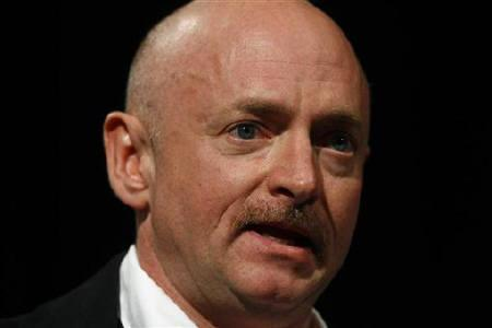 Mark Kelly, the husband of U.S. Congresswoman Gabrielle Giffords, speaks during a news conference at the University Medical Center in Arizona January 20, 2011. REUTERS/Joshua Lott