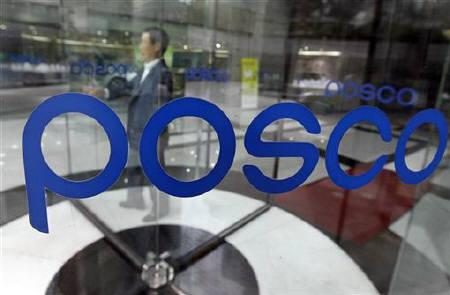 A man goes through a revolving door at the POSCO headquarters in Seoul August 30, 2010. REUTERS/Jo Yong-Hak/Files
