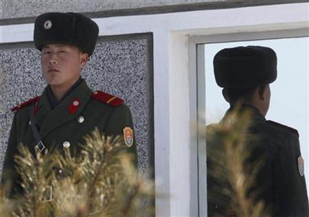 A North Korean soldier on the northern side of the truce village of Panmunjom looks south in the demilitarised zone that separates North Korea from South Korea in Paju, north of Seoul January 19, 2011. REUTERS/Lee Jae-Won