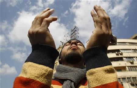 An Egyptian anti-government protester prays at Tahrir Square in downtown Cairo January 31, 2011. Protesters intensified their campaign on Monday to force Egypt's President Hosni Mubarak to quit as world leaders struggled to find a solution to a crisis that has torn up the Middle East political map. REUTERS/Amr Abdallah Dalsh