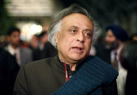 India's Environment Minister Jairam Ramesh speaks with journalists outside a plenary meeting at the United Nations Climate Change Conference (COP15) at the Bella Center in Copenhagen, early December 19, 2009.  REUTERS/Christian Charisius