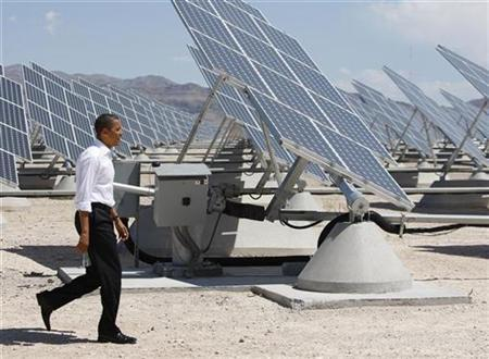 President Obama inspects an array of solar panels at Nellis Air Force Base in Las Vegas