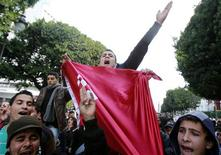 <p>Tunisian students shout slogans during a demonstration in Tunis February 1, 2011. Tunisia's security forces must be overhauled to stop them working against the people as they did during an uprising that toppled the president in which 147 people were killed, U.N. human rights official Bacre Waly Ndiaye said on Tuesday. REUTERS/Louafi Larbi</p>