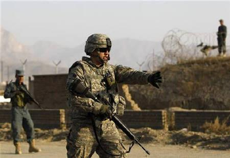 A U.S. soldier arrives at the site of a suicide car bomb attack in Kabul November 12, 2010. REUTERS/Omar Sobhani/Files