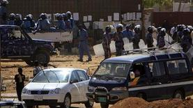 <p>Heavily armed police patrol Khartoum's main streets January 30, 2011. Police beat and arrested students in central Khartoum, witnesses said on Sunday, as demonstrations broke out throughout the city demanding the government resign. REUTERS/Stringer</p>