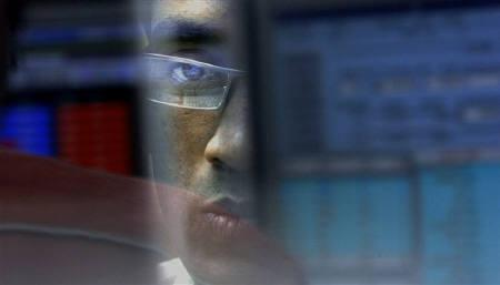 File photo of a stock broker looking at a terminal while trading at a brokerage firm in Mumbai November 17, 2008. REUTERS/Arko Datta/Files