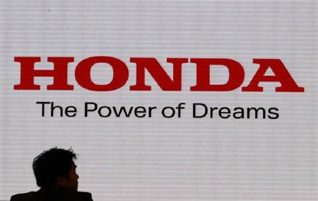 The logo of Honda Motor Co is screened at the company's showroom in Tokyo October 29, 2010. Honda Motor Co is looking to make small investments in North America to build more of its popular CR-V crossovers there, reducing exports from Japan to cushion the blow from a strong yen, an executive said. REUTERS/Issei Kato
