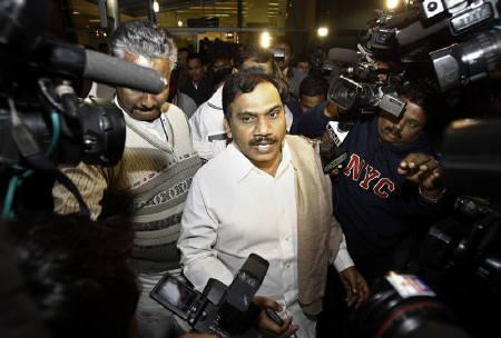 India's former telecommunications minister Andimuthu Raja (C) comes out of the airport in New Delhi December 22, 2010.REUTERS/Adnan Abidi/Files