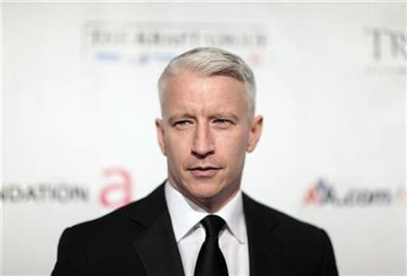 Television personality Anderson Cooper arrives at ''An Enduring Vision,'' a benefit dinner for the Elton John Aids Foundation in New York November 16, 2009. REUTERS/Lucas Jackson