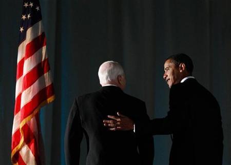 Then President-elect Barack Obama speaks with U.S. Senator John McCain at a bipartisan dinner honoring McCain in Washington, DC January 19, 2009. REUTERS/Jim Young
