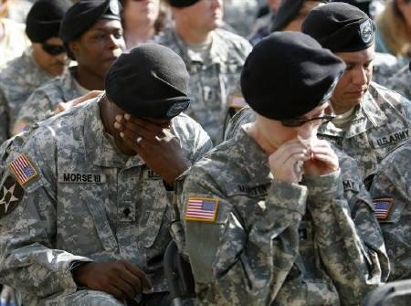 A soldier weeps during a memorial service at Fort Hood in Texas November 10, 2009.  REUTERS/Kevin Lamarque/Files