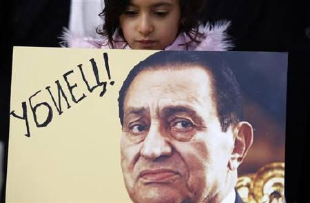 A girl displays a poster depicting Egypt's President Hosni Mubarak during a protest against him outside the Egyptian embassy in Sofia February 3, 2011. The poster reads, ''Murderer!''  REUTERS/Stoyan Nenov