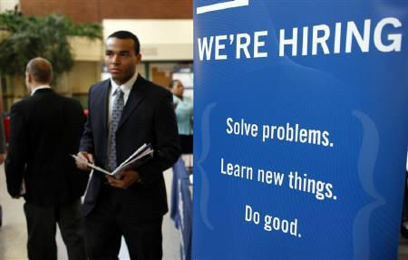 A job seeker walks the floor at a large career fair at Rutgers University in New Brunswick, New Jersey, January 6, 2011. REUTERS/Mike Segar/Files