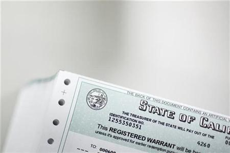 Registered warrants, or IOUs, are printed at the State Controller's office in Sacramento, California, July 2, 2009. REUTERS/Max Whittaker