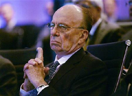 News Corporation Chairman and CEO Rupert Murdoch listens to morning discussion session during the Wall Street Journal CEO Council on ''Rebuilding Global Prosperity'' in Washington, November 17, 2009.  REUTERS/Hyungwon Kang/Files