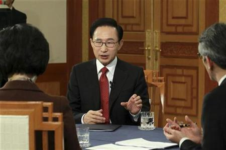 South Korean President Lee Myung-bak attends a live talk show broadcast which was directed by the office of the president at the presidential Blue House in Seoul February 1, 2011. REUTERS/Blue House/Handout