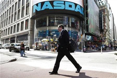 A pedestrian walks past the NASDAQ building in New York City in this April 30, 2010 file photo. REUTERS/Lucas Jackson