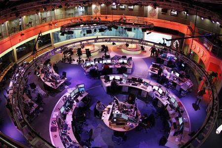 A general view shows the newsroom at the headquarters of the Qatar-based Al Jazeera English-language channel in Doha February 7, 2011. REUTERS/Fadi Al-Assaad