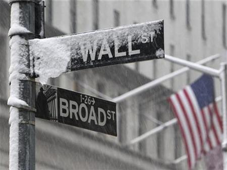 Snow covers a street sign at the corner of Wall St. and Broad St. in New York's financial district, February 10, 2010.. REUTERS/Brendan McDermid