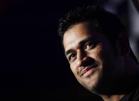 Captain Mahendra Singh Dhoni smiles during an event ahead of the Cricket World Cup in New Delhi February 2, 2011. REUTERS/Adnan Abidi