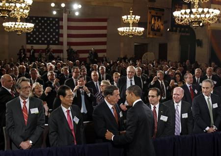 President Barack Obama greets guests after addressing the U.S. Chamber of Commerce in Washington, February 7, 2011. REUTERS/Jim Young