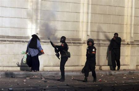 Police fire tear gas during a demonstration in Cairo January 28, 2011.  REUTERS/Asmaa Waguih/Files