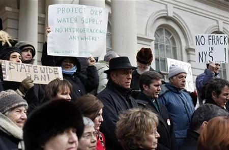 People gather on the steps of New York City Hall protesting the states plan for shale oil drilling in the city's watershed in New York January 4, 2010. REUTERS/Shannon Stapleton