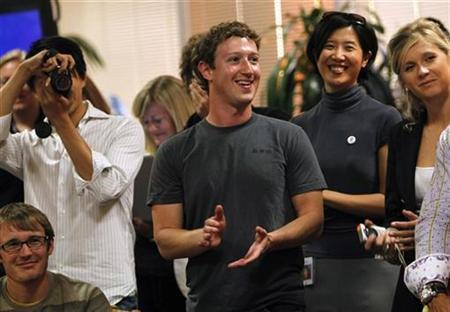 Facebook CEO Mark Zuckerberg (C) applauds while unveiling the company's new location services feature called ''Places'' during a news conference at Facebook headquarters in Palo Alto, California August 18, 2010. REUTERS/Robert Galbraith