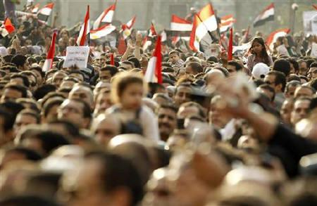 Protesters wave flags as they chant anti-government slogans during mass demonstrations inside Tahrir Square in Cairo February 8, 2011. REUTERS/Dylan Martinez