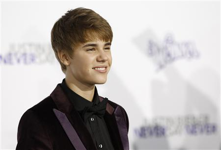 Singer Justin Bieber poses at the premiere of the documentary ''Justin Bieber: Never Say Never'' at Nokia theatre in Los Angeles, February 8, 2011. REUTERS/Mario Anzuoni