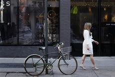 "<p>Reiss employee Marina Caputo models in a ""Nannette"" model dress made famous by British royal bride-to-be Kate Middleton on a street in New York February 8, 2011. REUTERS/Lucas Jackson</p>"