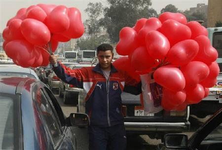 A man sells heart-shaped balloons for Valentines' Day in Cairo February 14, 2010. REUTERS/Asmaa Waguih