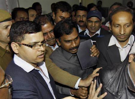 Former telecommunications minister Andimuthu Raja (C) leaves the court after his hearing in New Delhi February 10, 2011. REUTERS/Adnan Abidi