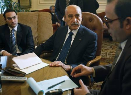 Egyptian Vice President Omar Suleiman talks to representatives from political parties in the Prime Minister's office in Cairo February 6, 2011. REUTERS/Asmaa Waguih