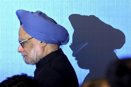 India's Prime Minister Manmohan Singh walks on stage for a photo opportunity as part of the 5th East Asia Summit in Hanoi October 30, 2010. REUTERS/Christophe Archambault/Pool/Files