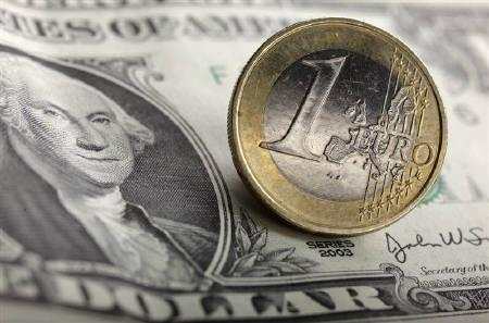 A picture illustration taken in Warsaw on January 18, 2011, shows an euro coin on one U.S. dollar banknotes. REUTERS/Kacper Pempel/Files