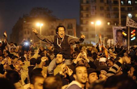 Anti-government protesters celebrate inside Tahrir Square after the announcement of Egyptian President Hosni Mubarak's resignation in Cairo February 11, 2011. REUTERS/Dylan Martinez