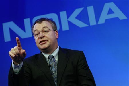 Nokia chief executive Stephen Elop speaks during a Nokia event in London February 11, 2011. Nokia and Microsoft teamed up to build an iPhone killer on Friday in a desperate attempt to take on Google and Apple in the fast-growing smartphone market. REUTERS/Luke MacGregor