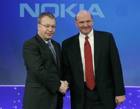 Nokia chief executive Stephen Elop (L) welcomes Microsoft chief executive Steve Ballmer with a handshake at a Nokia event in London February 11, 2011. REUTERS/Luke MacGregor