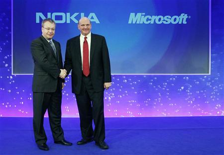 Nokia chief executive Stephen Elop welcomes Microsoft chief executive Steve Ballmer with a handshake at a Nokia event in London, February 11, 2011. REUTERS/Luke MacGregor